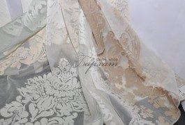 Тюль с вискозой классического дизайна с градацией цвета от темного к светлому.